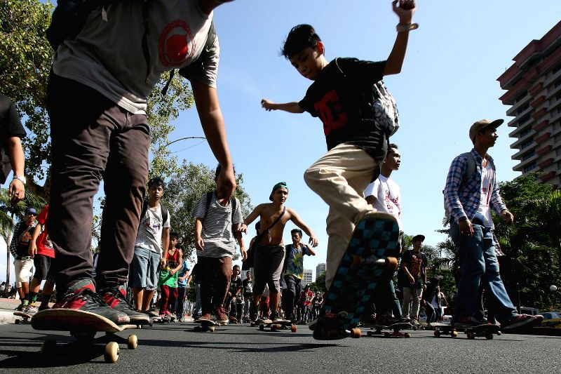 A skateboarder participates in a parade during Go Skateboarding Day in Manila, Philippines, on June 21, 2014. Skateboarders around the world celebrate Go ...