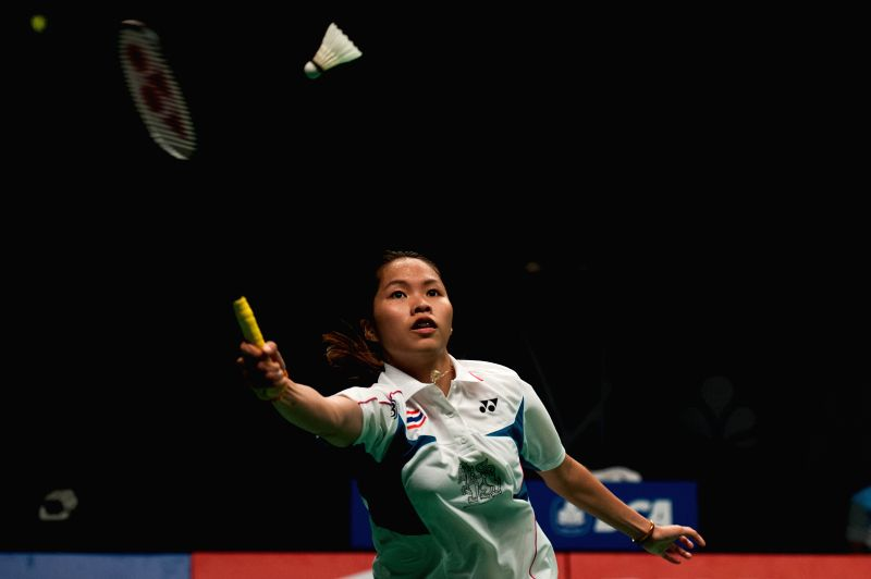 Ratchanok Intanon of Thailand returns a shot during her women's singles semifinal against Wang Shixian of China at BCA Indonesia Open 2014 in Jakarta, Indonesia, on .