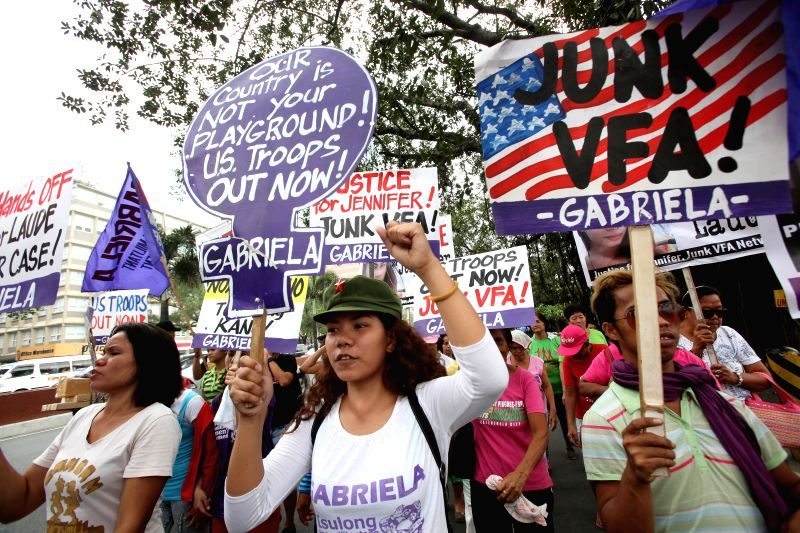 Activists hold placards during a protest rally near the U.S. Embassy in Manila, the Philippines, March 24, 2015. Activists called for justice for the killed ...