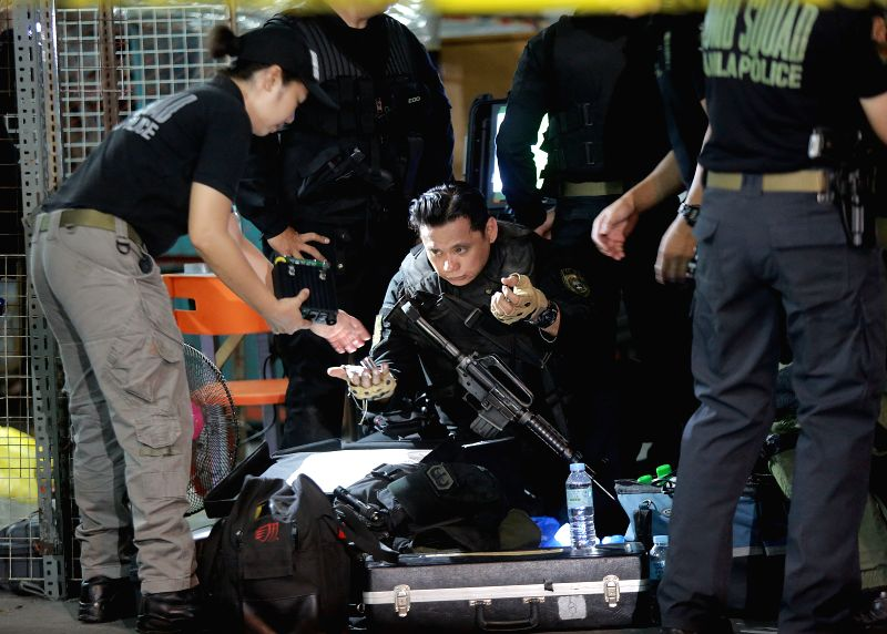 MANILA, May 6, 2017 - Police officers prepare their equipment as they investigate an area where twin blasts occurred in Manila, the Philippines, on May 6, 2017. Two people were killed and four others ...