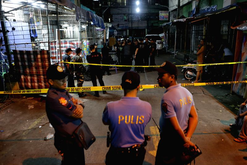 MANILA, May 6, 2017 - Police officers secure the area where twin blasts occurred in Manila, the Philippines, on May 6, 2017. Two people were killed and four others injured, including a policeman, in ...