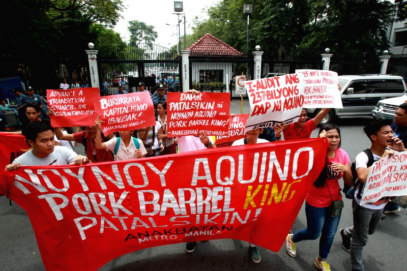 Activists hold placards during a protest condemning the termination of the impeachment case against President Benigno Aquino III in Manila, the Philippines, Sept. 3,
