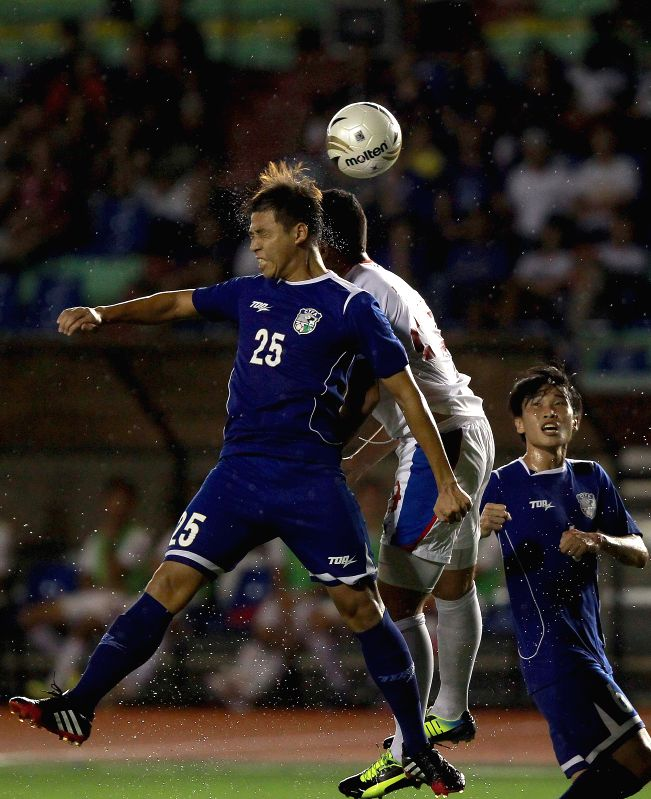 Patrick Reichelt of the Philippines (C) heads for the ball with Chen Shan-Fu (L) and Lee Chun-Chia of Chinese Taipei during the PFF Peace Cup in Manila, capital of ..