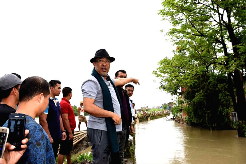Manipur Chief Minister N Biren Singh pays a visit to areas adjoining Sanjenthong bridge to inspect the situation of floods, in Imphal on June 14, 2018. Torrential rains in the fast few days ... - N Biren Singh