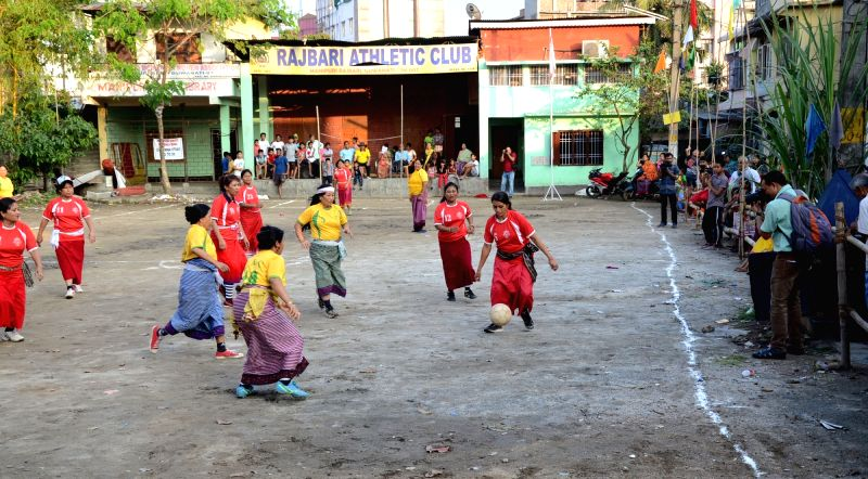 Manipuri women in their traditional attire take part in a friendly football match at Manipur Basti in Guwahati on April 20, 2017.