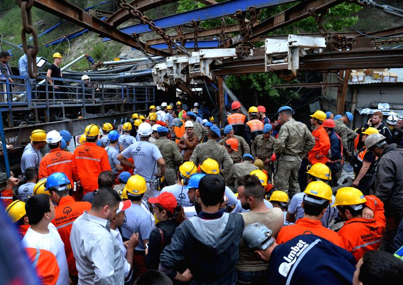 People rescue the trapped miners in Manisa on May 14, 2014. A transformer was exploded at a coal mineshaft of a privately-owned mine in the Soma district of Turkey's .