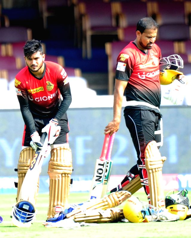 Manish Pandey and Yusuf Pathan of Kolkata Knight Riders during a practice session ahead of their playoff match against Sunrise Hyderabad at Chinnaswamy Stadium in Bengaluru on May 16, 2017. - Manish Pandey
