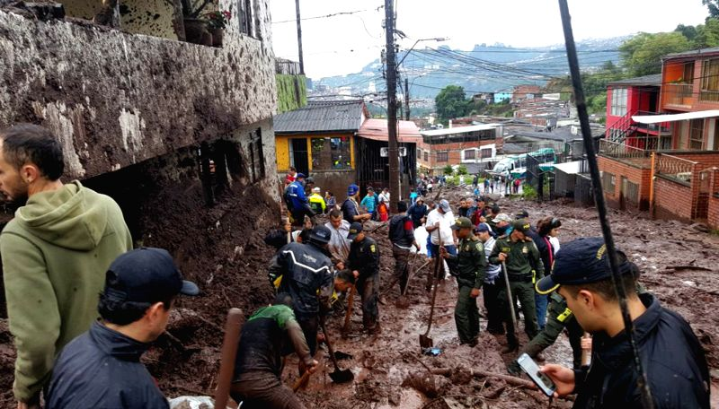 MANIZALES, April 20, 2017 - Rescuers remove mud and debris at the site of a landslide in Manizales, Colombia, on April 19, 2017. At least 11 people were killed in landslides in central-western ...