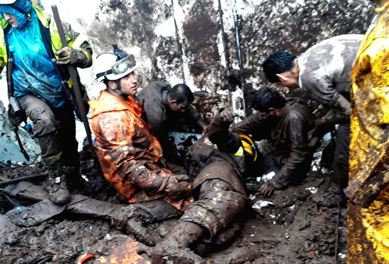 MANIZALES, April 20, 2017 - Rescuers work at the site of a landslide in Manizales, Colombia, on April 19, 2017. At least 11 people were killed in landslides in central-western Colombia on Wednesday, ...