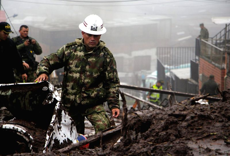 MANIZALES (COLOMBIA), April 19, 2017 A soldier works at the site of a landslide in Manizales, Colombia, on April 19, 2017. At least 11 people were killed in landslides in central-western ...