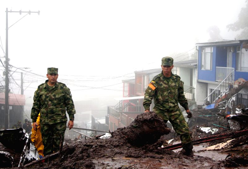 MANIZALES (COLOMBIA), April 19, 2017 Soldiers work at the site of a landslide in Manizales, Colombia, on April 19, 2017. At least 11 people were killed in landslides in central-western ...