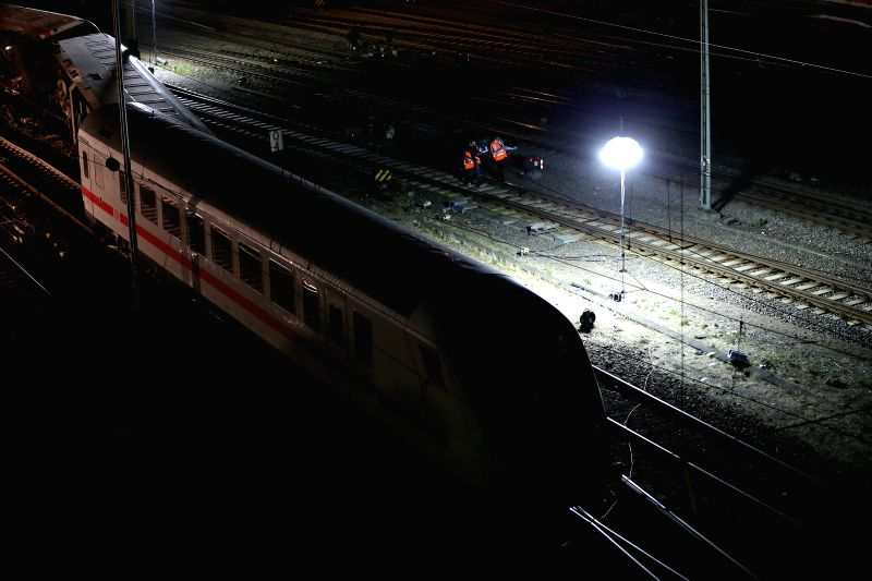 MANNHEIM(GERMANY), Aug. 2, 2014 Rescuers gather at the accident scene where a passenger train collided with a freight train, in the southern German city of Mannheim, Aug. 2, 2014. ...
