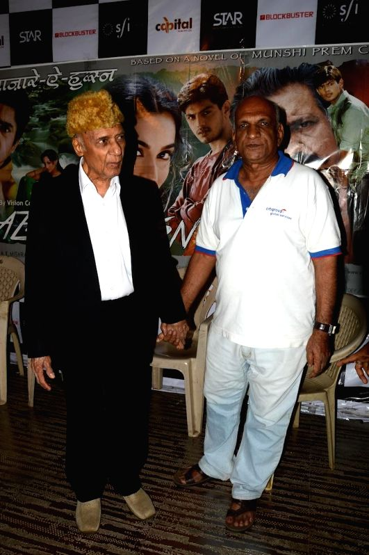 Manohar Thakur and Music director Khayyam Sahab during a press meet of film Bazaar-E-Husn based on Munshi Premchandji's Urdu novel in Mumbai on July 11, 2014.