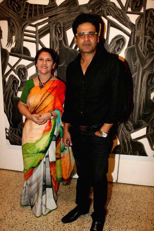 Manoj Bajpai grace poet and artist Kiran Chopra's exhibition at Jehangir Art Gallery. - Kiran Chopras and Manoj Bajpai