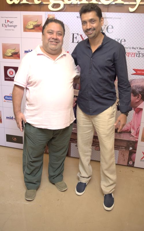Manoj Phawa with Raj.V.shetty (Director) during the premiere of film Love Exchange in Mumbai on Oct 28, 2015.