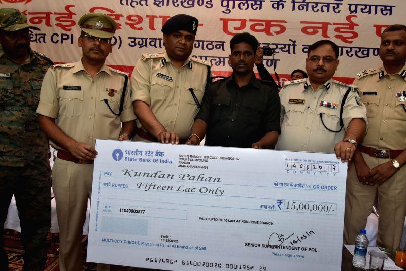 Maoist leader Kundan Pahan surrenders before police in Ranchi on May 14, 2017.