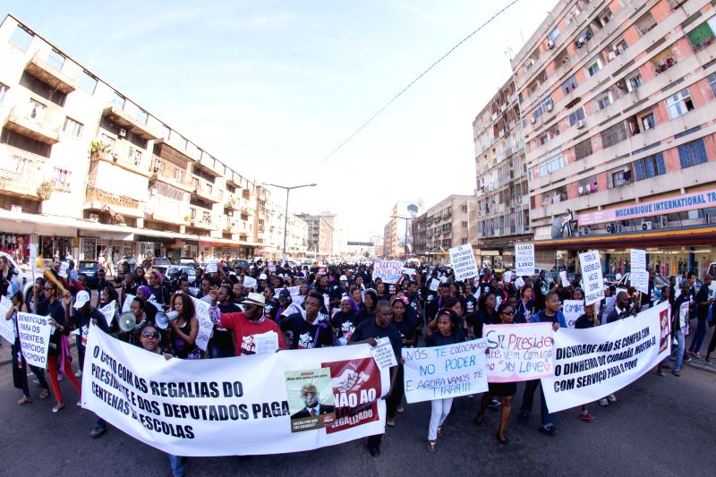 Protestors march on a street in Maputo, Mozambique, on May 16, 2014. Protestors marched on Friday against the parliament bill that ensures parliamentarians' pensions .