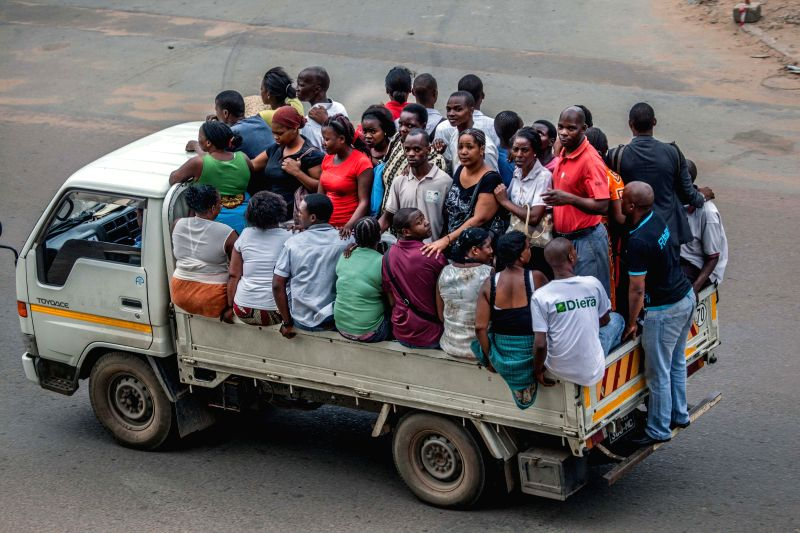 Maputo (Mozambique): Local citizens travel on a crowded truck in Maputo, Mozambique, on Nov.20, 2014. The southern African country Mozambique has gained a rapid economic development in recent years. .