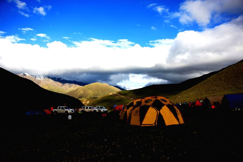 Expedition members have a rest at a camp on the mountainous area of Amne Machin peak in Maqen County of Golog Tibetan Autonomous Prefecture, northwest China's Qinghai