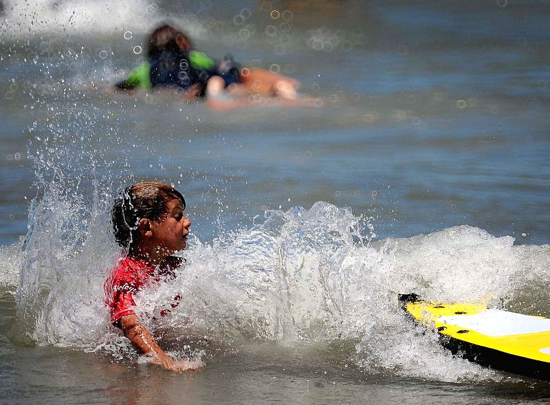 A boy plays in the sea in the beach of Mar del Plata, Argentina, on Jan. 10, 2015.
