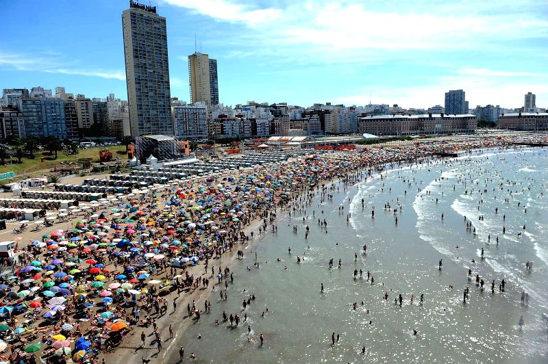 People visit the beach in Mar del Plata, Argentina, on Jan. 10, 2015.