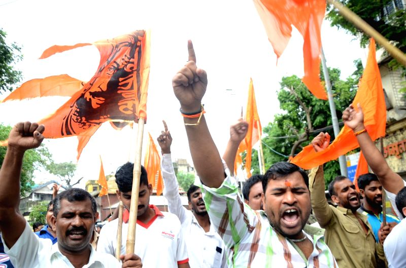 Maratha activists stage a demonstration seeking suitable reservations in government jobs and education amid Maharashtra shutdown, in Mumbai on July 25, 2018. Large groups of Maratha activists ...
