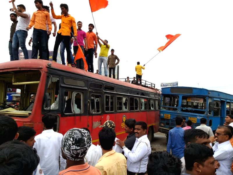 Maratha activists staging a demonstration seeking suitable reservations in government jobs and education, block the streets disrupting normal traffic movement; in Pune on July 30, 2018.