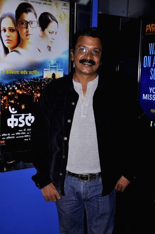 Marathi film actor Rajendra Shisatkar during the premiere of Marathi film Candle March in Mumbai, on Dec 5, 2014. - Rajendra Shisatkar