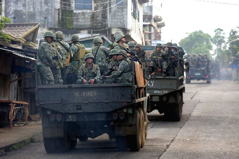 MARAWI CITY, June 2, 2017 - Government soldiers are seen on trucks in Lanao Del Sur Province, the Philippines, June 2, 2017. More elite troops were sent to the besieged Marawi City in the southern ...