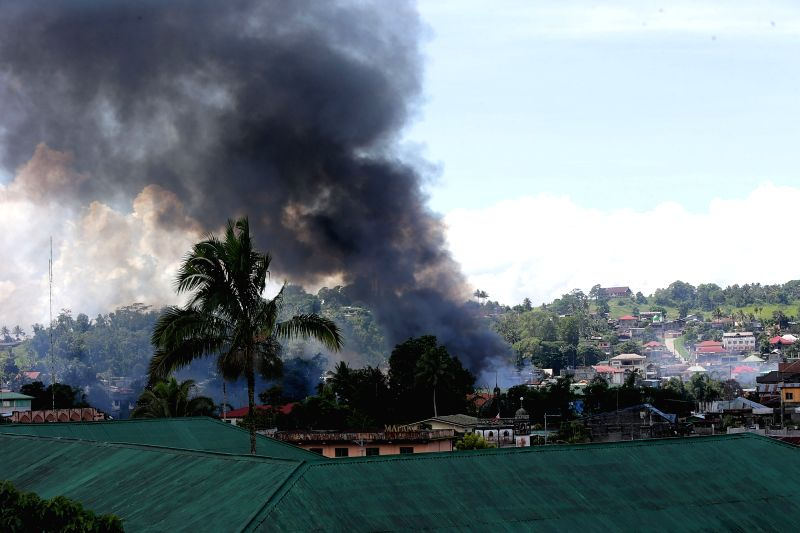 MARAWI CITY, June 2, 2017 - Smoke billows from a residential area during an airstrike in Marawi City, Lanao Del Sur Province, the Philippines, June 2, 2017. More elite troops were sent to the ...