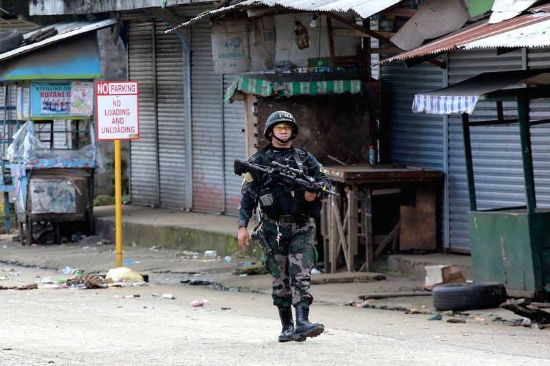 MARAWI CITY, May 31, 2017 - A member of the Philippine National Police Special Action Force secures an area in Marawi City, Lanao Del Sur Province, the Philippines, May 31, 2017. More than 100 ...