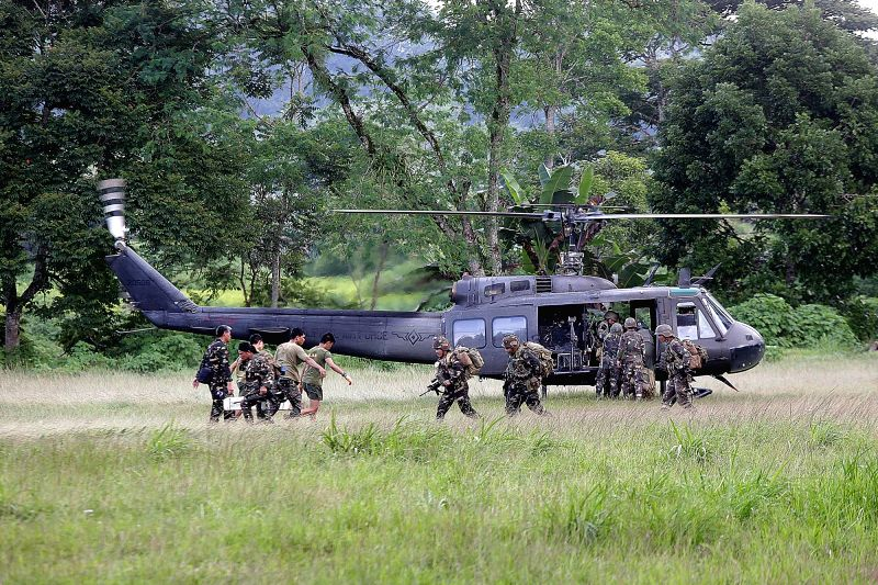MARAWI, June 2, 2017 - Government soldiers board a military helicopter as they continue their assault against insurgents from the Maute militant group in Lanao Del Sur Province, the Philippines, June ...