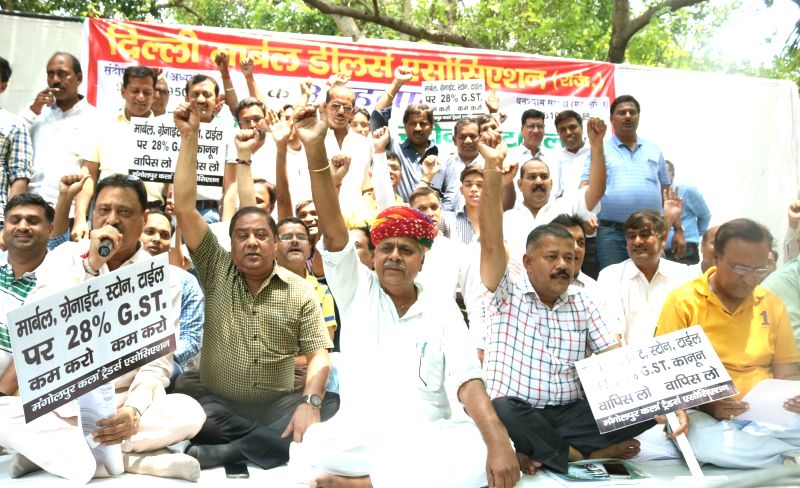 Marble dealers stage a demonstration against GST in New Delhi, on June 1, 2017.