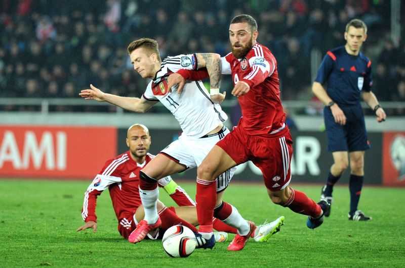 : Marco Reus (C) of Germany vies with Guram Kashia (R) of Georgia during their UEFA Euro 2016 Group D qualifying match at Mikheil Meskhi stadium in Tbilisi, ...
