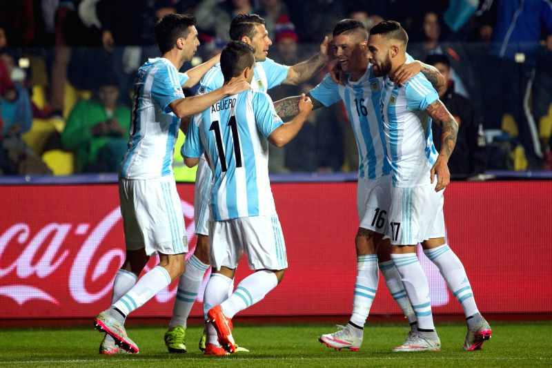 Marcos Rojo (2nd R) of Argentina celebrates with his teammates after scoring during the semifinal between Argentina and Paraguay at the 2015 Copa America, in ...