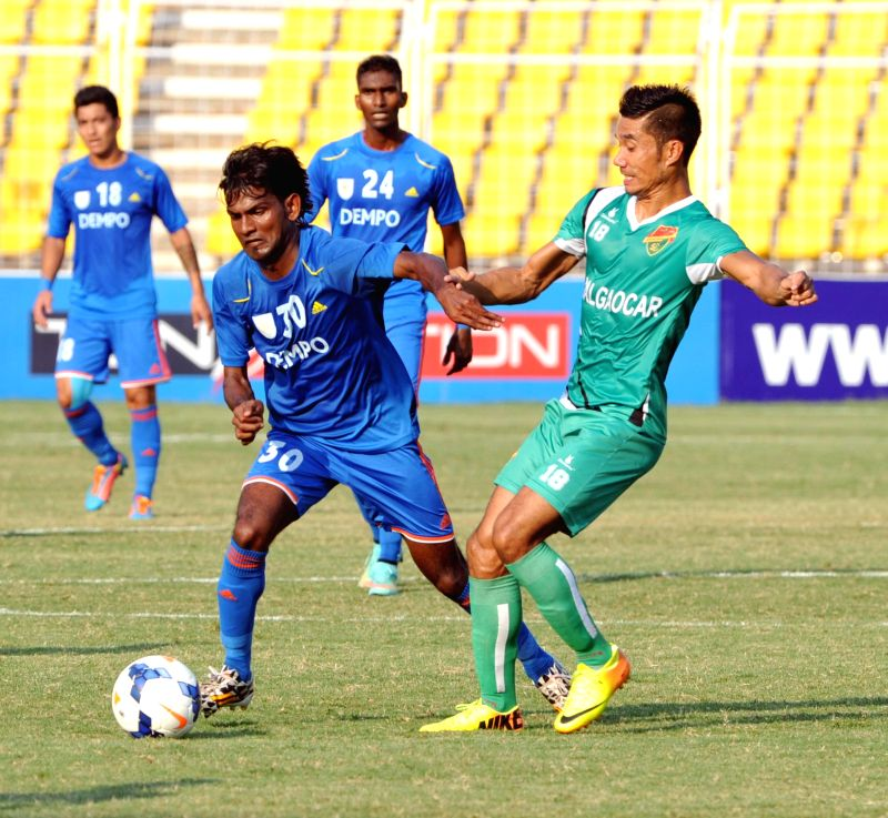 Players in action during Federation Cup semifinal match between Dempo Sports Club and Salgaocar Football Club in Margao, Goa on Jan 9, 2015.