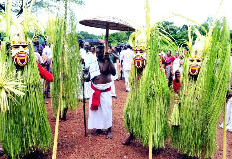 Mari Theyyam performance underway during Malayalam month of Karkidakam at Madayi Kavu in Kannur of Kerala on Aug 2, 2016.