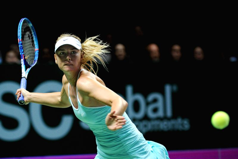 Maria Sharapova of Russia reacts during the WTA Finals match against Flavia Pennetta of Italy in Singapore, Oct. 29, 2015. Sharapova won 2-0. (Xinhua/Then Chih ...