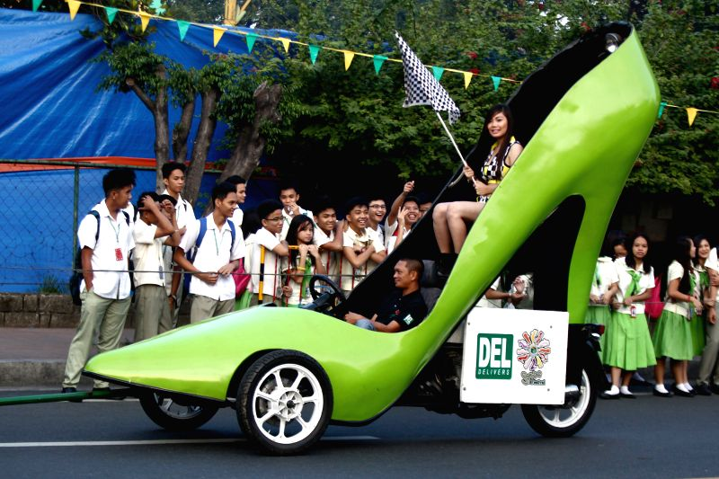 "Marikina City: A giant shoe car cruises during the ""Tour de Takong"" (Tour of High Heels) in Marikina City, the Philippines, on Nov. 13, 2014. Residents took part in the annual Tour of High ."