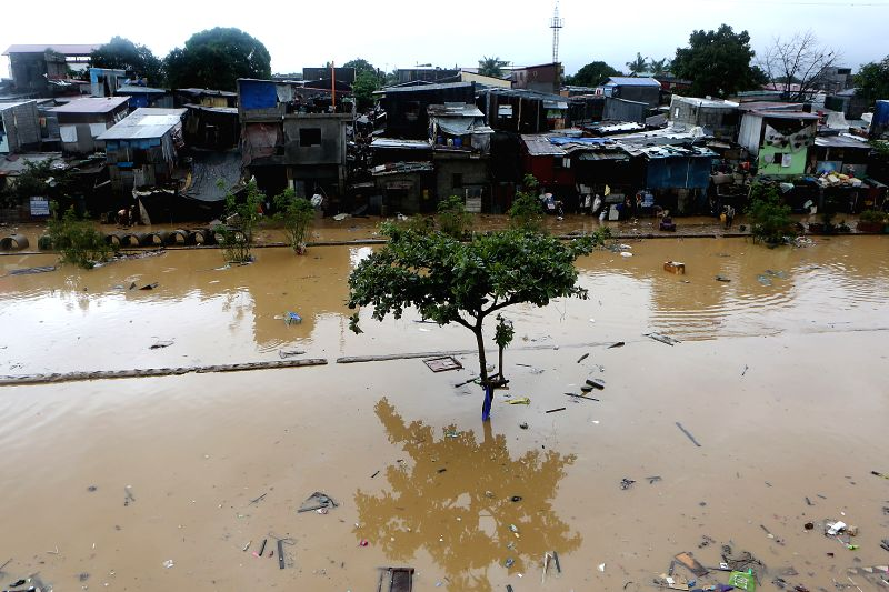 MARIKINA CITY, Aug. 12, 2018 - Shanties are submerged in flood brought by tropical storm Yagi in Marikina City, the Philippines, Aug. 12, 2018.