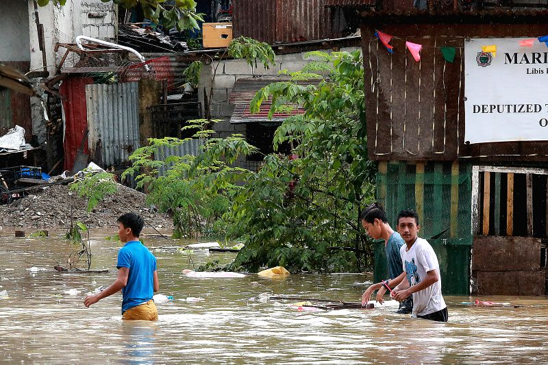 MARIKINA CITY, July 22, 2018 - Residents wade through flood water brought by heavy rains in Marikina City, the Philippines, July 22, 2018. At least five people died and more than 700,000 were ...