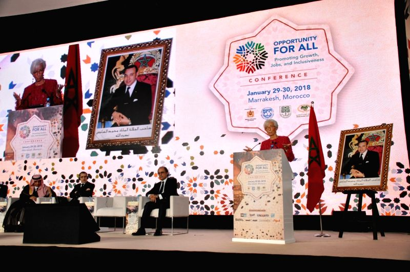 MARRAKECH, Jan. 30, 2018 - International Monetary Fund (IMF) Managing Director Christine Lagarde (R) speaks during a high-level conference of IMF in Marrakech, Morocco, Jan. 30, 2018. Christine ...