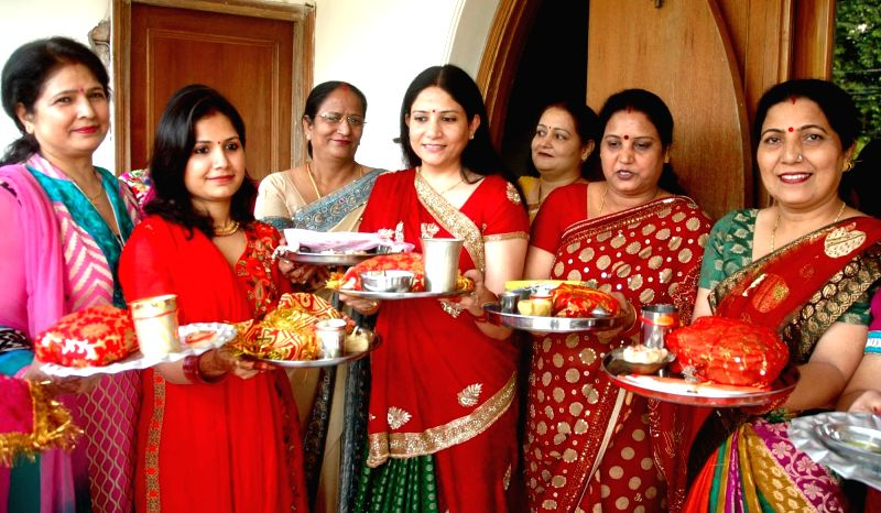 Married women celebrate Karwa Chauth in Patna on Oct 30, 2015.