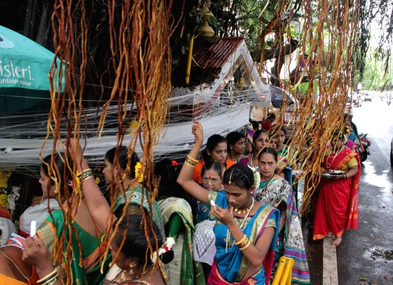 Married womens tieing the sacred thread around the Banyan tree on the occasion of Vatt Pournima in Panaji on June 8, 2017.