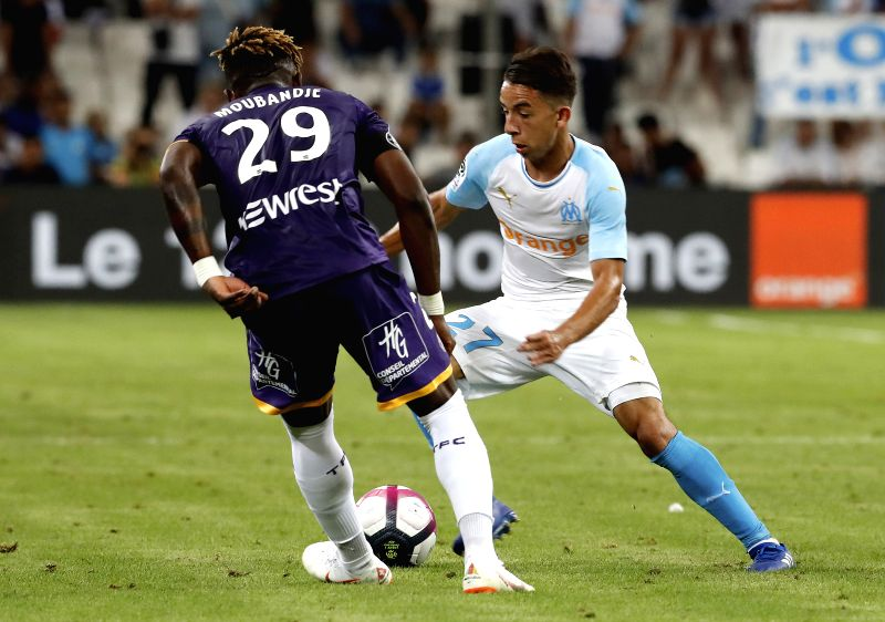 MARSEILLE, Aug. 11, 2018 - Maxime Lopez (R) of Marseille vies with Francois Moubandje of Toulouse during the French Ligue 1 football match 2018-19 season 1st round in Marseille, France on Aug. 10, ...