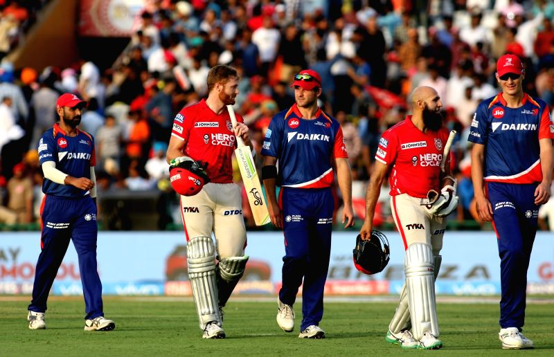 Martin Guptill and Hashim Amla of Kings XI Punjab celebrate after winning an IPL 2017 match between Kings XI Punjab and Delhi Daredevils at Punjab Cricket Association IS Bindra Stadium in ...
