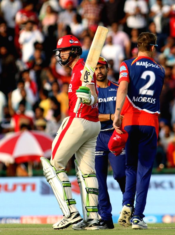 Martin Guptill of Kings XI Punjab celebrates his half century during an IPL 2017 match between Kings XI Punjab and Delhi Daredevils at Punjab Cricket Association IS Bindra Stadium in Mohali ...