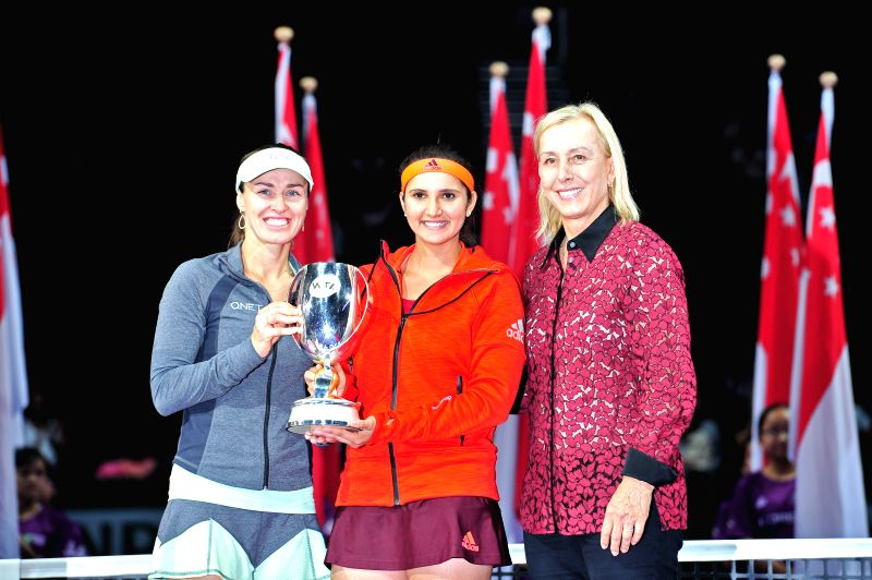 Martina Hingis (L) of Switzerland and Sania Mirza (C) of India attend the awarding ceremony after winning WTA's women's doubles final match against Garbine ... - Martina Hingis and Sania Mirza
