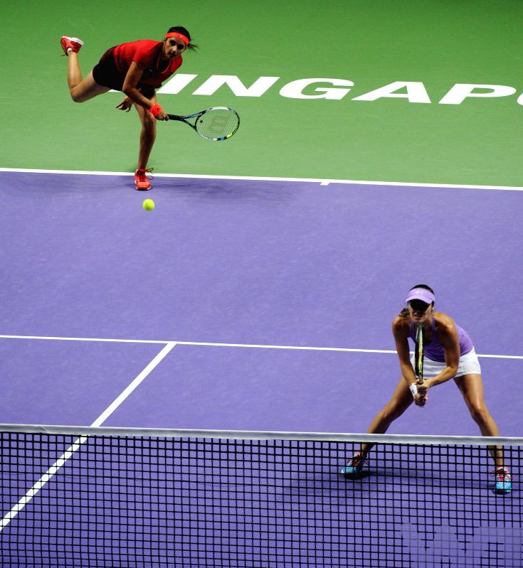 Martina Hingis (R) of Switzerland and Sania Mirza of India compete during the women's doubles semi-final match against Chan Hao-Ching and Chan Yung-Jan of ...