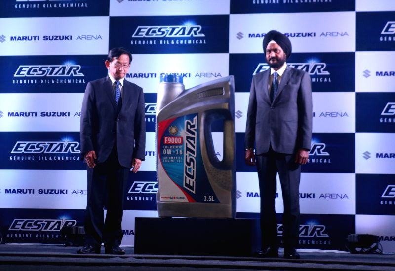 Maruti Suzuki CEO and Managing Director Kenichi Ayukawa with an official at the launch of  Ecstar Engine Oil OW16, in New Delhi, on July 19, 2018.
